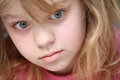 Closeup portrait of little blond caucasian girl in pink Royalty Free Stock Photography