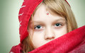 Closeup portrait of little blond girl in red Royalty Free Stock Image