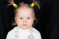 Closeup portrait of little girl with funny scrunchy on the head Royalty Free Stock Photos