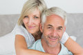Closeup portrait of a loving mature couple in bed at home Stock Images