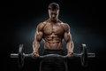 Closeup portrait of a muscular man workout with barbell at gym Royalty Free Stock Photo