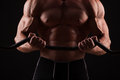 Closeup portrait of a muscular man workout with barbell at gym. Royalty Free Stock Photo