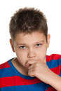 Closeup portrait of a pensive young boy Royalty Free Stock Photo