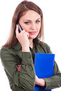Closeup portrait of a pretty young businesswoman talking on mob mobile phone against white Royalty Free Stock Photos