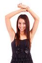 Closeup portrait of a pretty young  lady with arms up Royalty Free Stock Photography