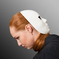 Closeup portrait of red headed woman with white mask worn on the back of her head Royalty Free Stock Photos