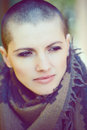 Closeup portrait of sad beautiful Caucasian white young bald girl woman with shaved hair head Royalty Free Stock Photo