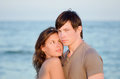 Closeup portrait of a sensual young couple on the beach Stock Photography