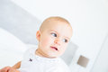 Closeup portrait of a smiling cute baby over blurred background Royalty Free Stock Photos