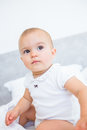 Closeup portrait of a smiling cute baby over blurred background Royalty Free Stock Photo
