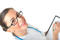 Closeup portrait of smiling female doctor writing on clipboard caucasian attractive with blue stethoscope neck white background Stock Photography