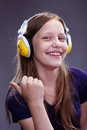 Closeup portrait of a smiling teen girl with headphones studio shot Stock Images