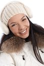 Closeup portrait of smiling winter girl young woman dressed up warm at wintertime Stock Image