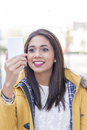 Closeup portrait of smiling woman holding phone and looking mess happiness smart Royalty Free Stock Images