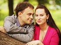 Closeup portrait of smiling young couple in love outdoors Stock Photos