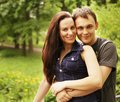 Closeup portrait of smiling young couple in love outdoors Stock Images