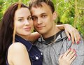 Closeup portrait of smiling young couple in love outdoors Royalty Free Stock Images