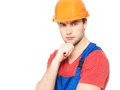 Closeup portrait thinking handyman uniform isolated white background Stock Images