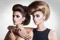 Closeup portrait of two beauty fashion women with creative volum Royalty Free Stock Photo