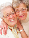 Closeup portrait of two older woman smiling Stock Images