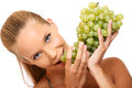Closeup portrait of a woman bites in grape Stock Image