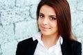 Closeup portrait of a young beautiful businesswoman near brick wall Stock Image