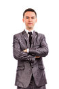 Closeup portrait of a young businessman with arms folded isolated on white background Royalty Free Stock Images