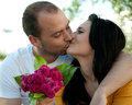 Closeup portrait young couple in love outdoors Stock Photos