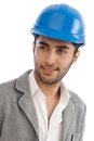 Closeup portrait of young engineer handsome smiling in hardhat Royalty Free Stock Photography