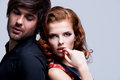 Closeup portrait of young sexy couple in love passionate posing at studio evening clothes Stock Photo