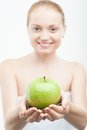 Closeup portrait of young woman holding coffee in white towel beans and green apple selected focus isolated on white Royalty Free Stock Photo