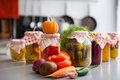 Closeup of preserved vegetables in glass jars Royalty Free Stock Photo