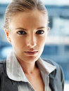 Closeup of a pretty business woman, serious look Stock Photos