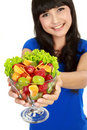 Closeup of a pretty young girl with fruit salad Royalty Free Stock Photos