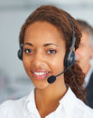 Closeup of pretty young secretary using a headset Royalty Free Stock Photos