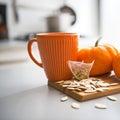 Closeup on pumpkins seeds and tea bag on table Royalty Free Stock Photo