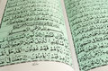Closeup of qur an open arabic with focus on the start new chapter Royalty Free Stock Images