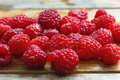 Closeup raspberries fresh on a wooden background Stock Photo