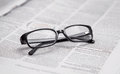Closeup of reading glasses on the newspaper Royalty Free Stock Image