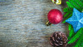 Closeup of red christmas balls and pine cones and bell and star Royalty Free Stock Photo
