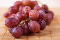 Closeup red large bunch grapes background wooden table Royalty Free Stock Photography