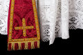 Closeup red vestment set maniple white lace priest surplice Stock Images