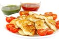 Closeup of roasted fish with green and red sauce in oven garnish cherry tomato Stock Photos