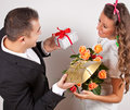 Closeup of romantic couple in love man giving his wife a surprise gifts valentine concept Stock Photos