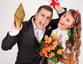 Closeup of romantic couple in love man giving his wife a surprise gifts valentine concept Stock Image