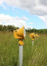 Closeup on runway landing lights in grass field Royalty Free Stock Photo