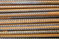 A closeup of rusty horizontally stacked steel division reinforcement bars rebar Royalty Free Stock Photo