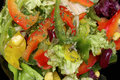 Closeup of salad with fresh vegetables on black plate Royalty Free Stock Photo