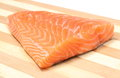 Closeup of salmon steak on wooden background portion portion fish Royalty Free Stock Photo