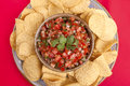 Closeup of salsa and chips. Royalty Free Stock Images